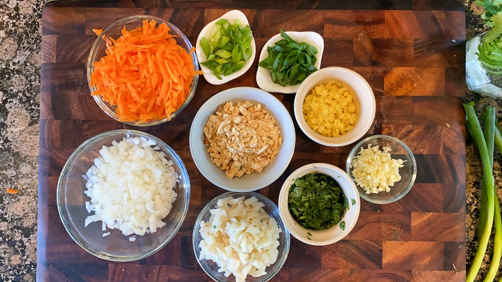 carrots, onion, peanuts, ginger, garlic, prepped in separate bowls