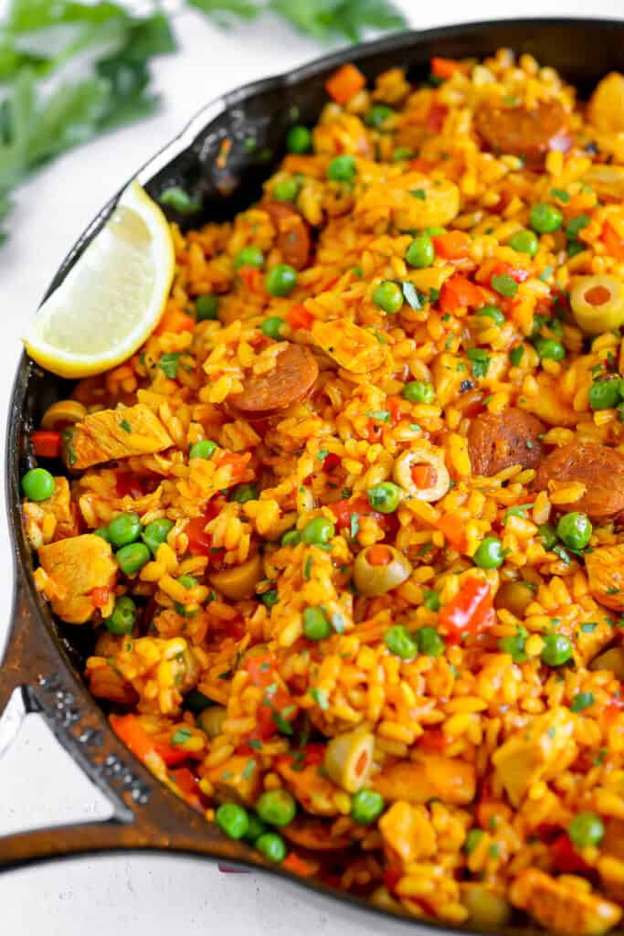 close up of chicken and chorizo paella in a cast iron skillet