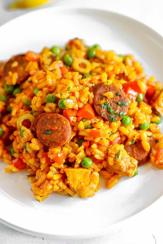 serving of chicken paella on a white plate