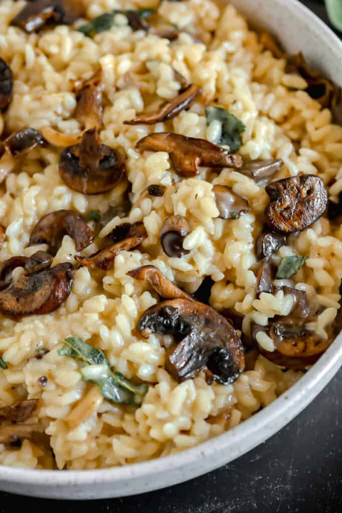 close up of mushroom sage risotto in a bowl
