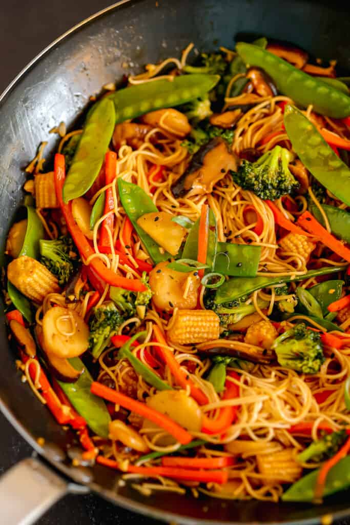 lo mein and veggies in a wok