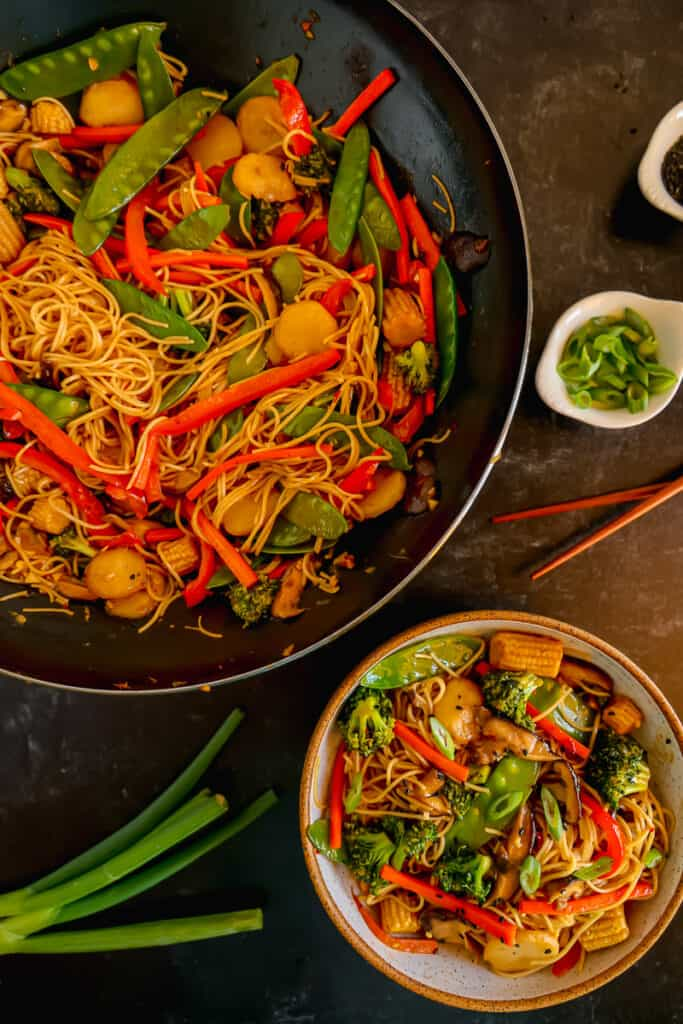 vegetable lo mein in a wok and in a small bowl