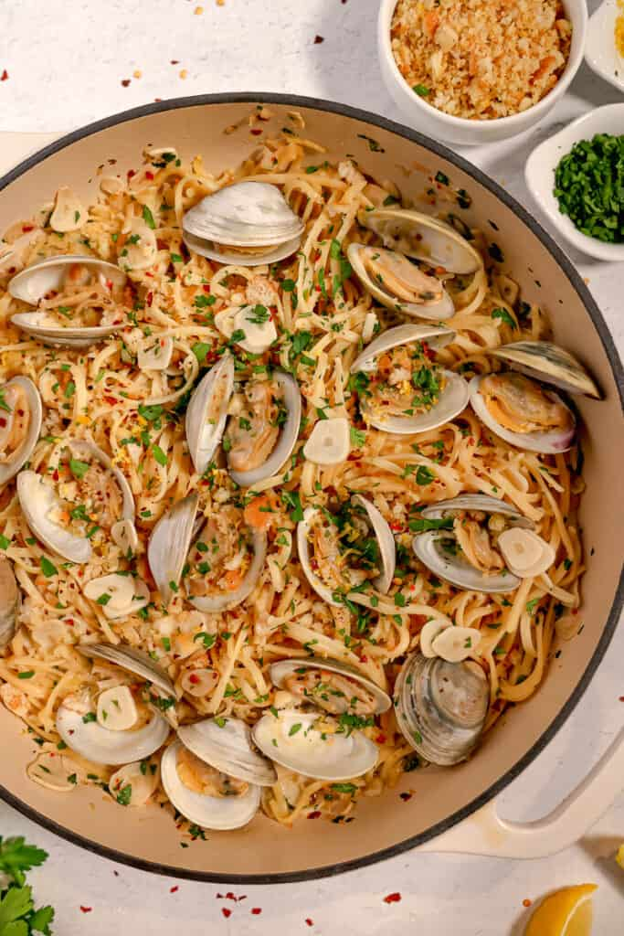 overhead of linguine and clams with breadcrumbs and fresh produce