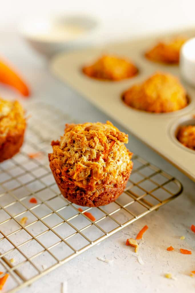 a carrot cake muffin on a gold cooling rack
