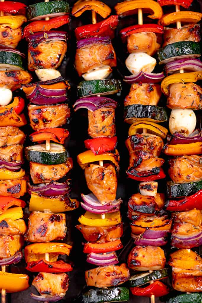 close up of grilled chicken and veggie skewers