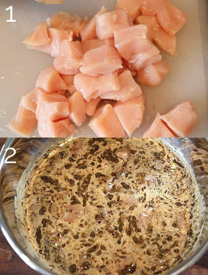 diced chicken on a cutting board being added into marinade in a bowl