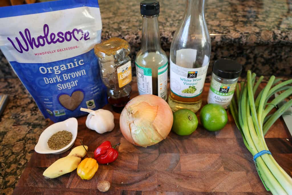 jerk chicken marinade ingredients spread on a cutting board