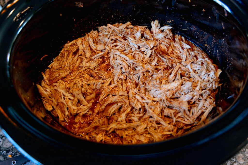 shredded Mexican spiced chicken in a crockpot
