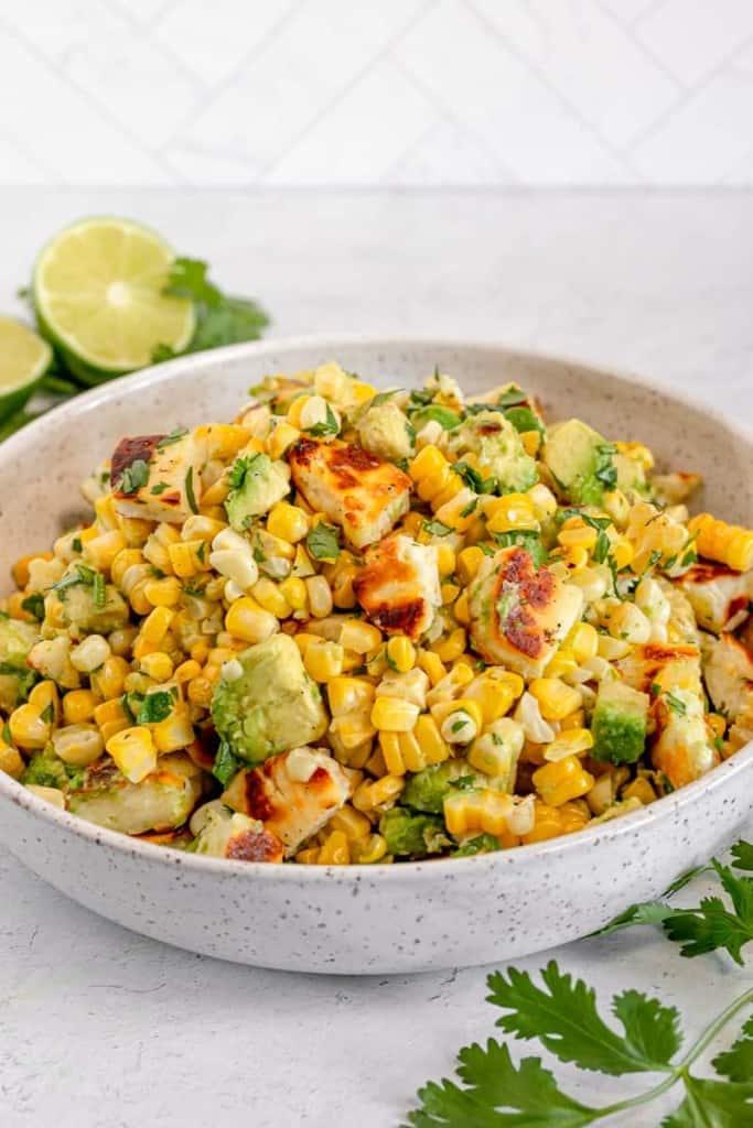 corn and halloumi in a white bowl
