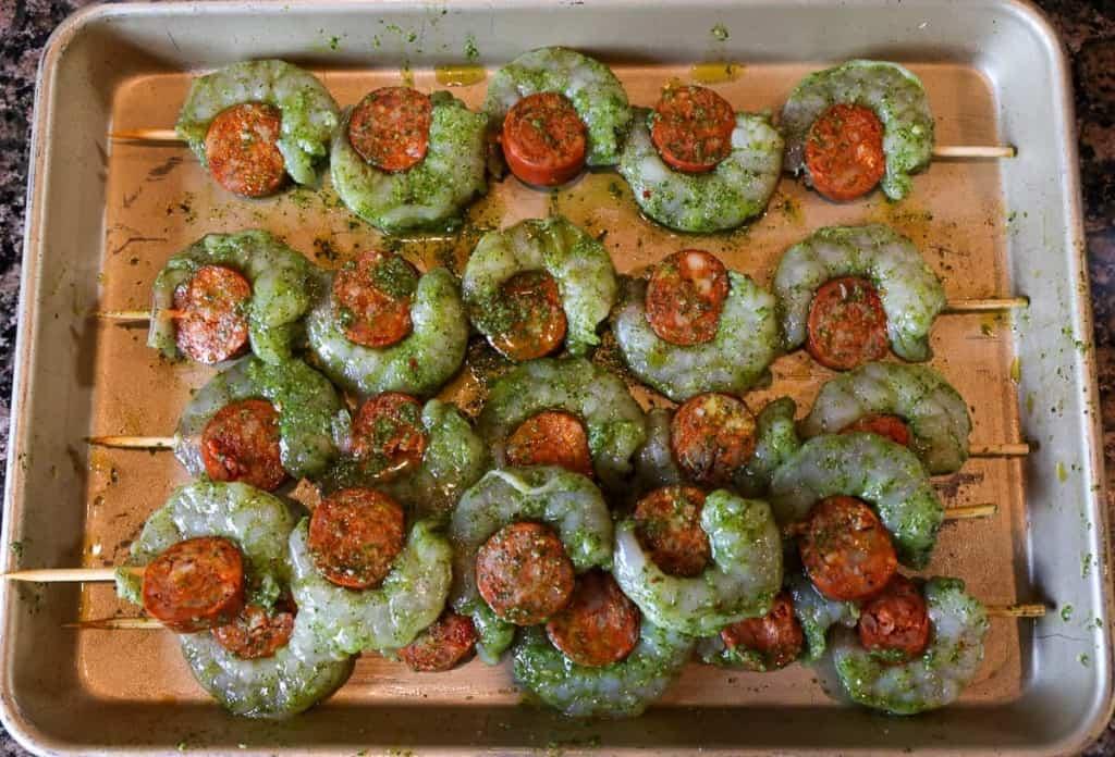 skewering herb marinated shrimp and chorizo pre-grill