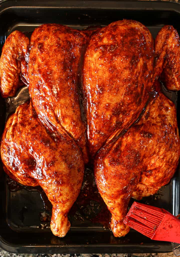spatchcocked chicken with Peruvian marinade brushed on skin