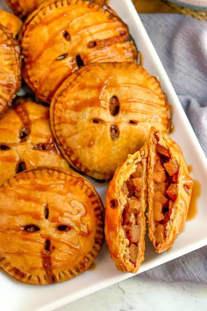 apple pie hand pie cut in half exposing diced apples inside