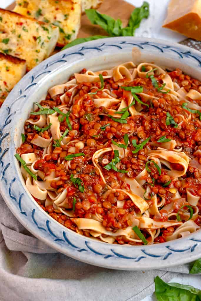 close up of lentil bolognese sauce over tagliatelle