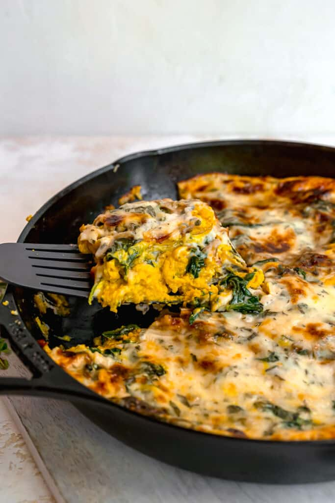 slice of squash lasagna being lifted out of the skillet