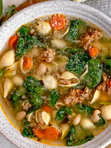 soup bowl with white beans, hot italian sausage, spinach, and carrots
